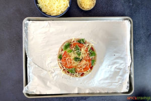 Assembled pizza margarita on a baking tray