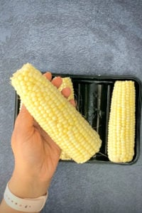 Holding a clean ear of corn in one hand