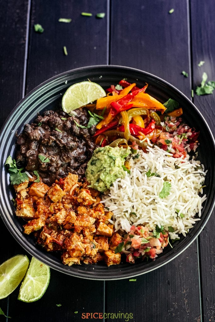 Burrito bowl with sofritas, beans, rice, grilled peppers, guac and salsa