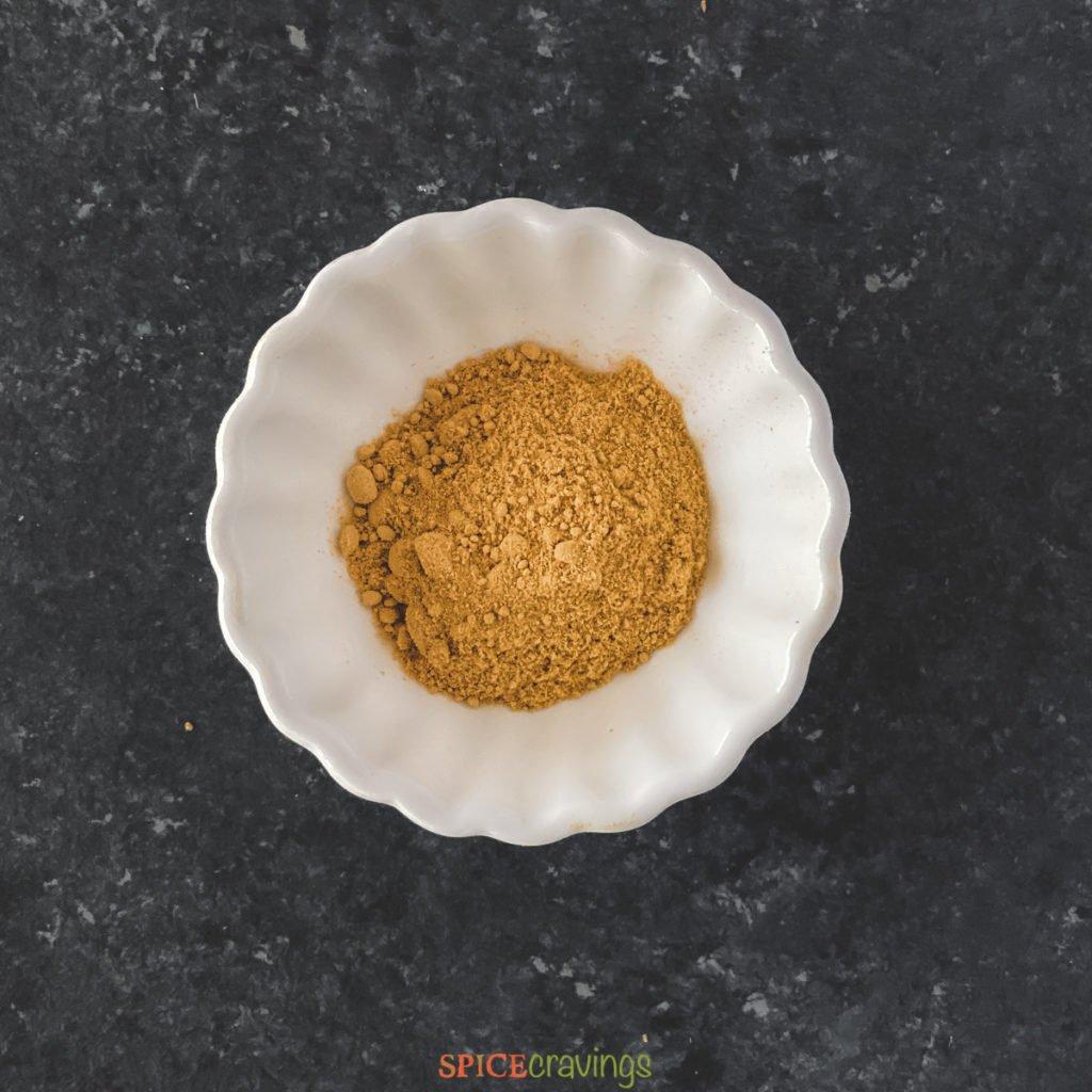 cardamom powder in white bowl