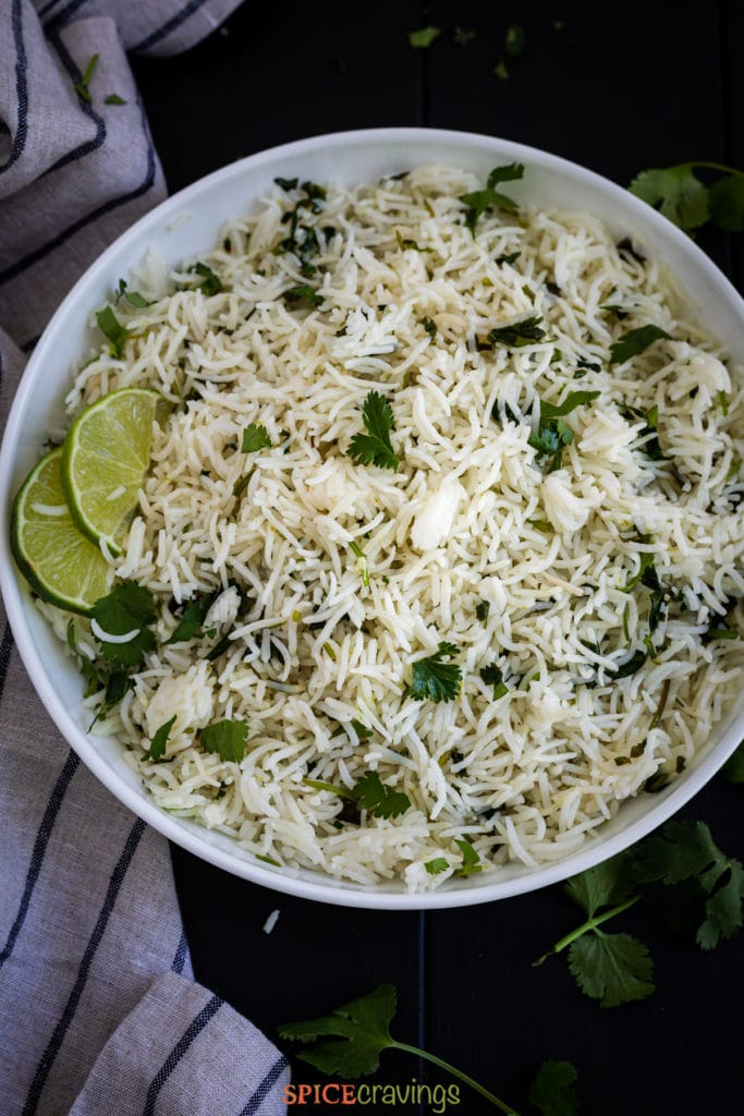 Rice with cilantro and lime in white bowl