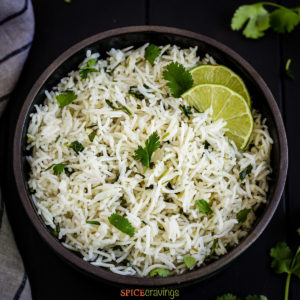 Bowl of cilantro lime rice with 2 lime slices