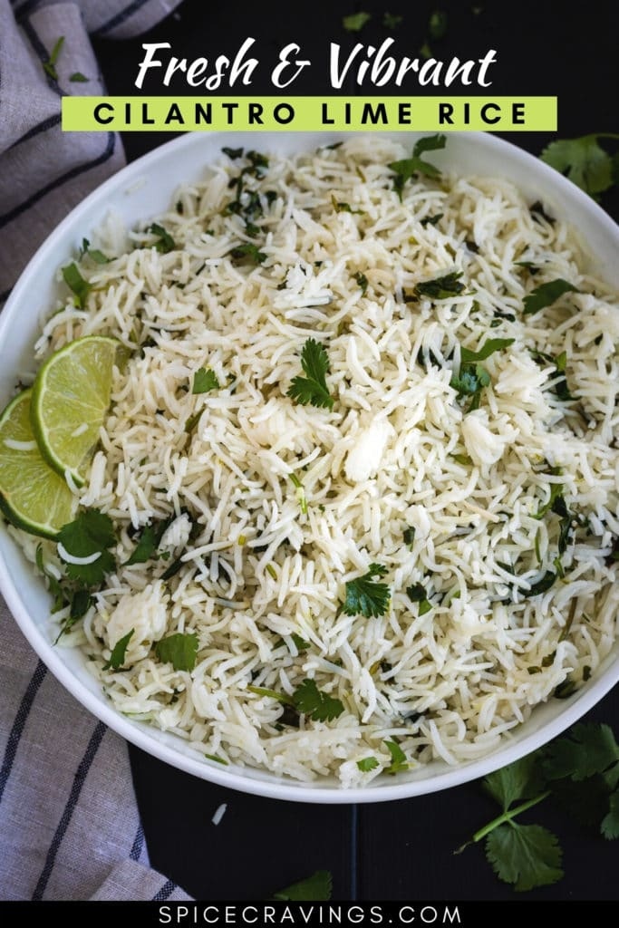 Cilantro lime rice in white bowl with lime slices