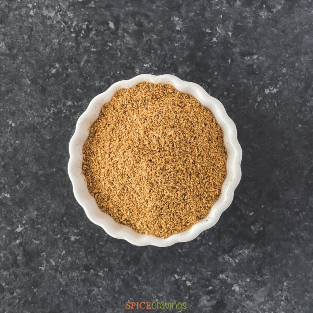 ground coriander in white bowl