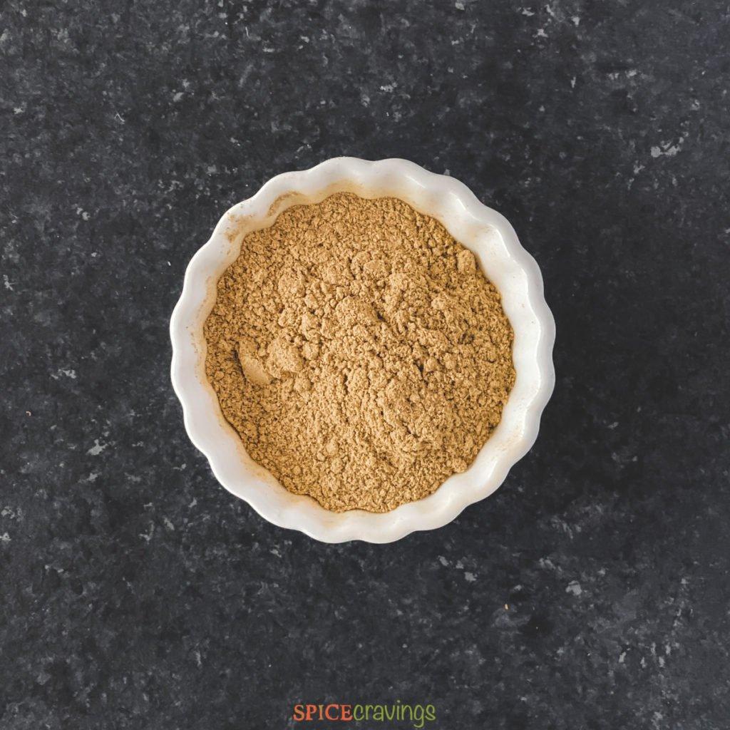 ground ginger in white bowl
