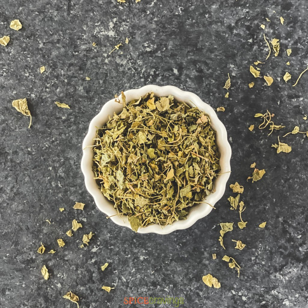 dried fenugreek leaves in white bowl