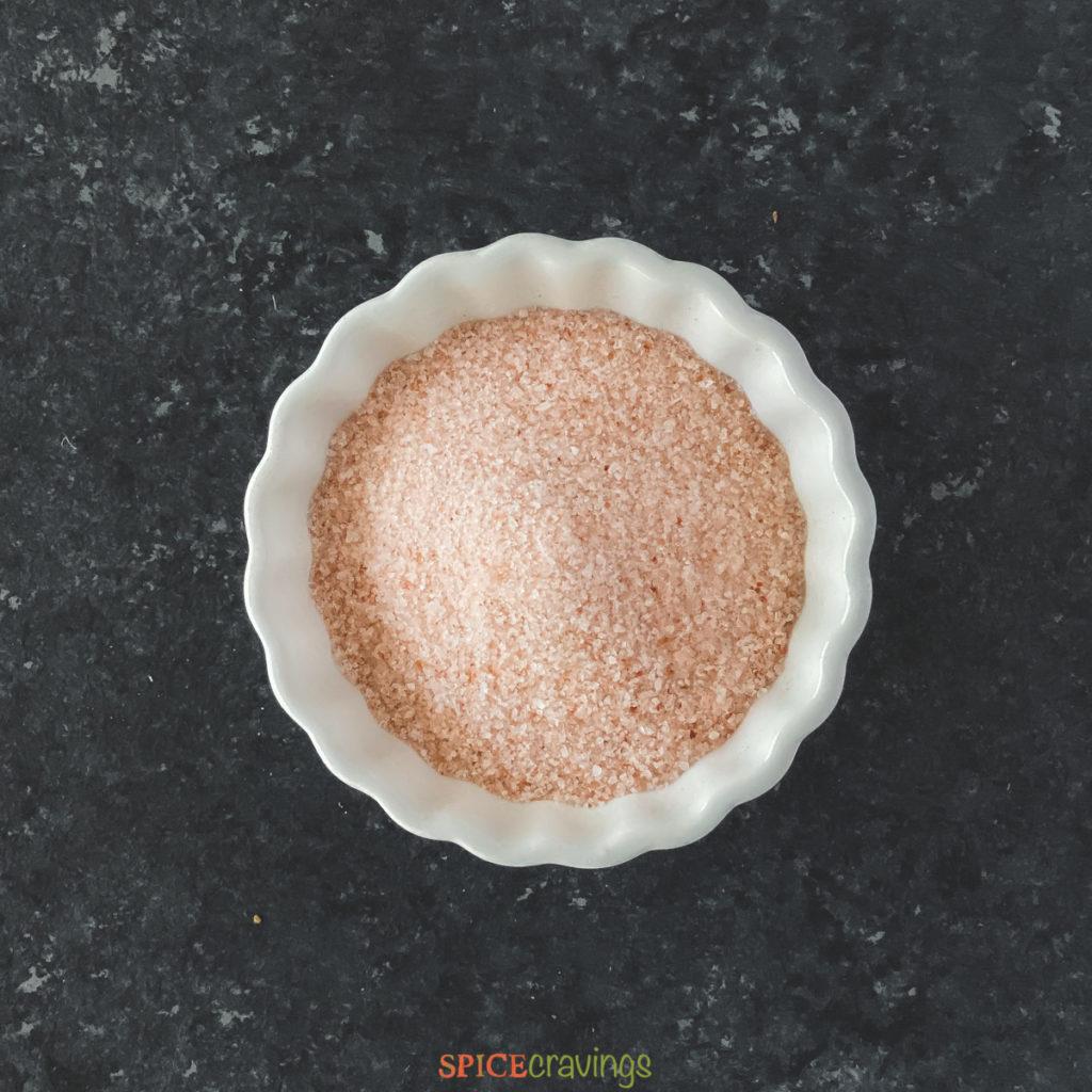 pink himalayan salt in white bowl