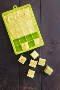 ginger paste cubes in green ice cube tray