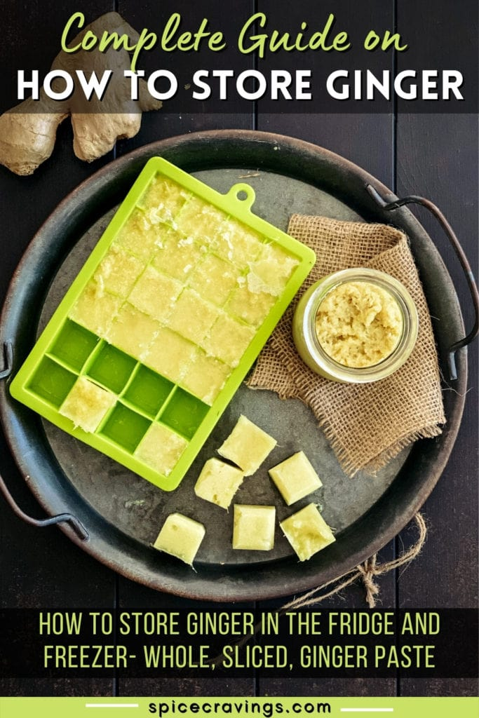 ginger root with ginger paste jar and ice cube trays on metal tray