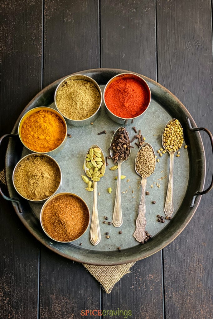 A tray with assorted whole and ground Indian spices