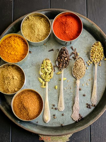 Ground and whole Indian Spices on a metal tray