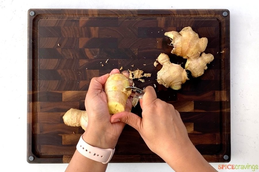 Peeling ginger root with a spoon