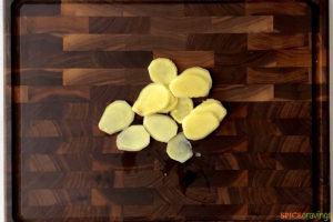 Slices of ginger on a cutting board