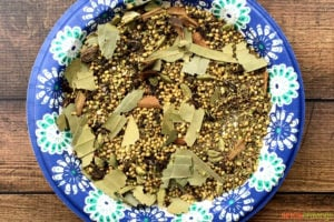 Whole spices on floral paper plate