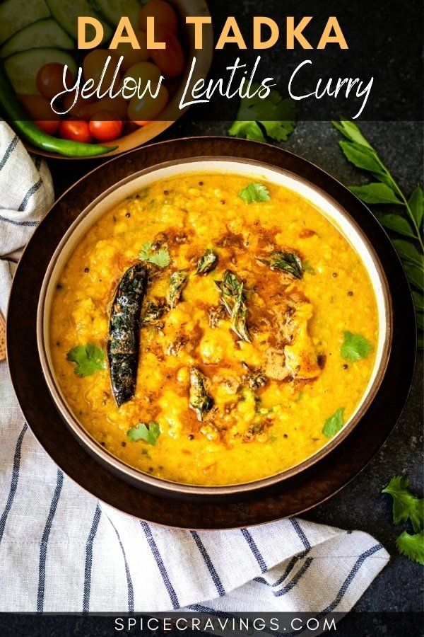 Yellow lentil curry garnished with cilantro and tadka