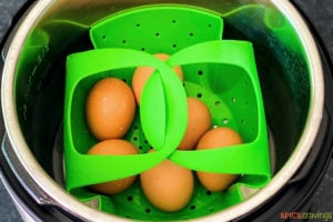Eggs placed in green steamer basket