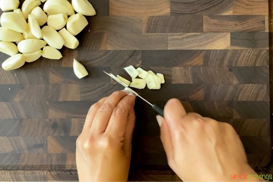 slicing garlic cloves with knife