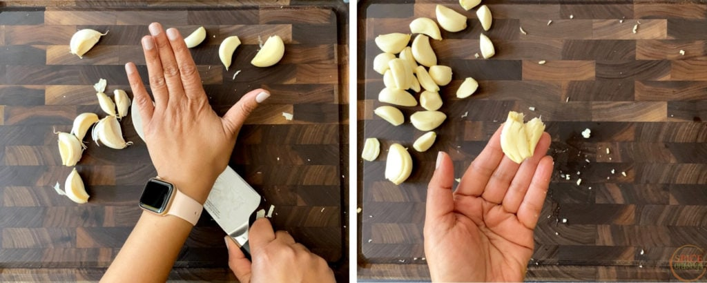 two hands crushing garlic cloves