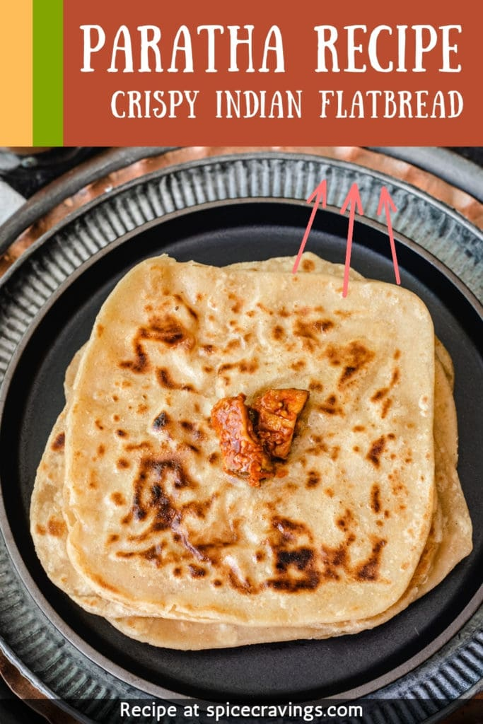 Paratha topped with indian pickle with title banner on top