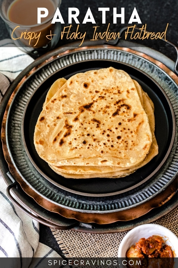 Stack of paratha with pickle on the side