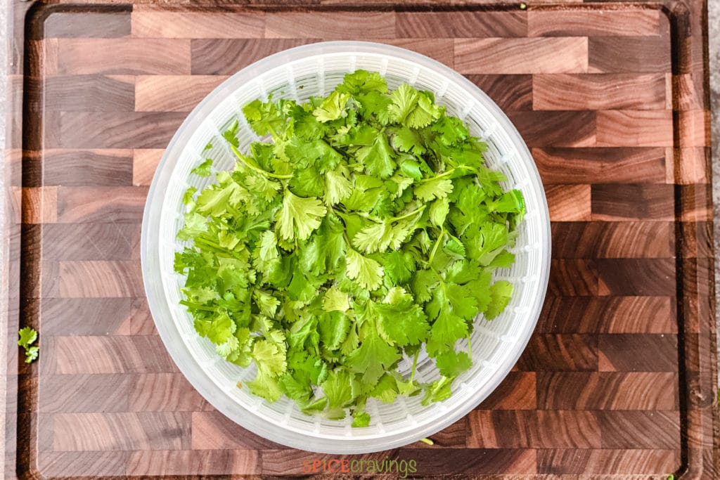 rinsing whole cilantro in salad spinner