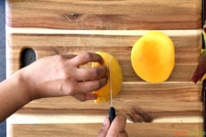 Cutting mango around the pit
