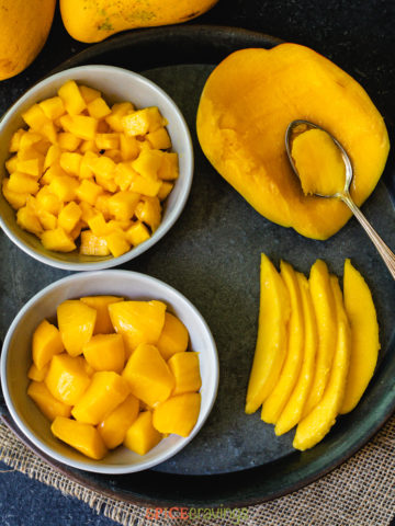 mango sliced, cubed, diced and scooped with a spoon