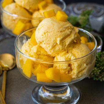mango ice cream in glass bowl