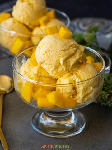 Mango ice cream in bowl topped with chopped mango