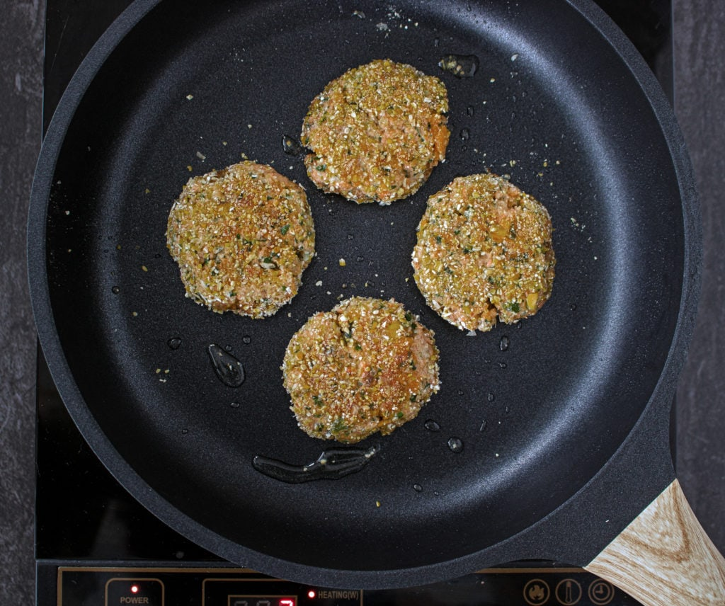 Cooking salmon patties in non-stick pan on the stove