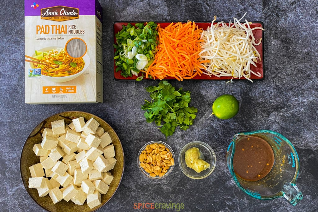 cubed tofu, rice noodles, sliced onions and carrots, bean sprouts, thai sauce, ginger garlic, peanuts