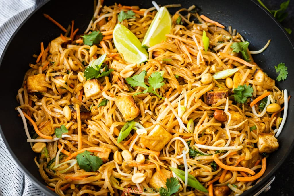 pad thai with noodles and tofu in wok