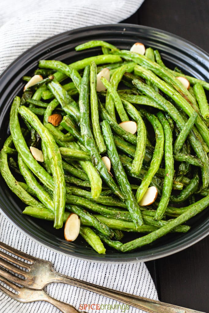 plate of air fryer green beans garnished with almond chips