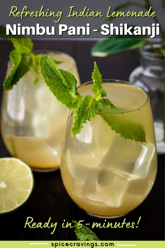 Two glasses with ice and lemonade garnished with mint