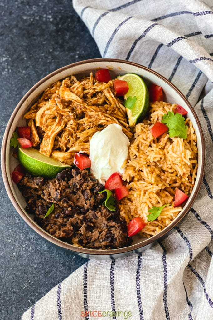 Bowl with rice, beans and shredded chicken