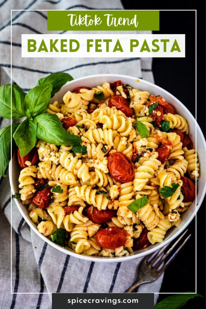 Pasta with tomato, basil and feta in a white bowl