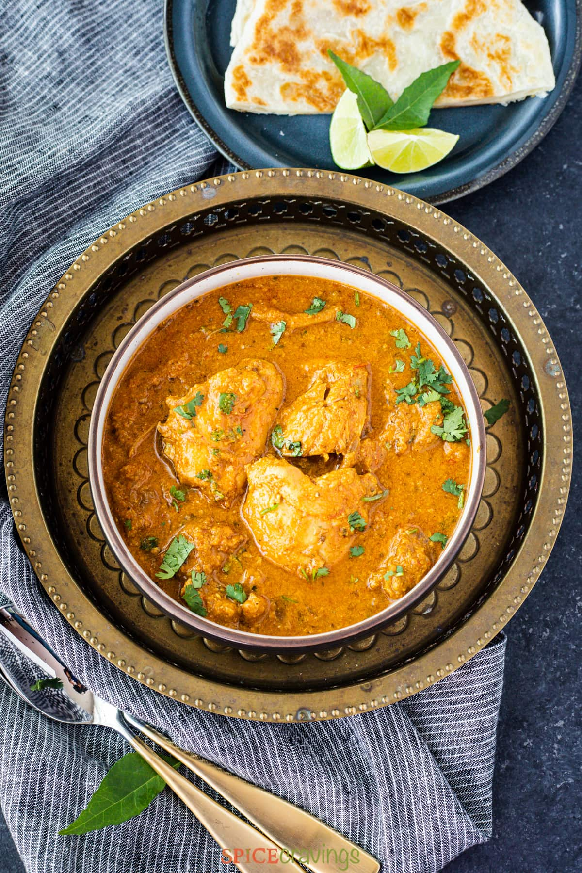chicken pepper curry in bowl on metal plate