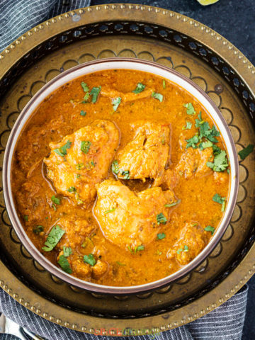 easy south indian chicken chettinad in bowl on metal plate
