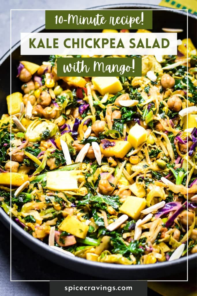 Kale chickpea salad topped with mango in a pan