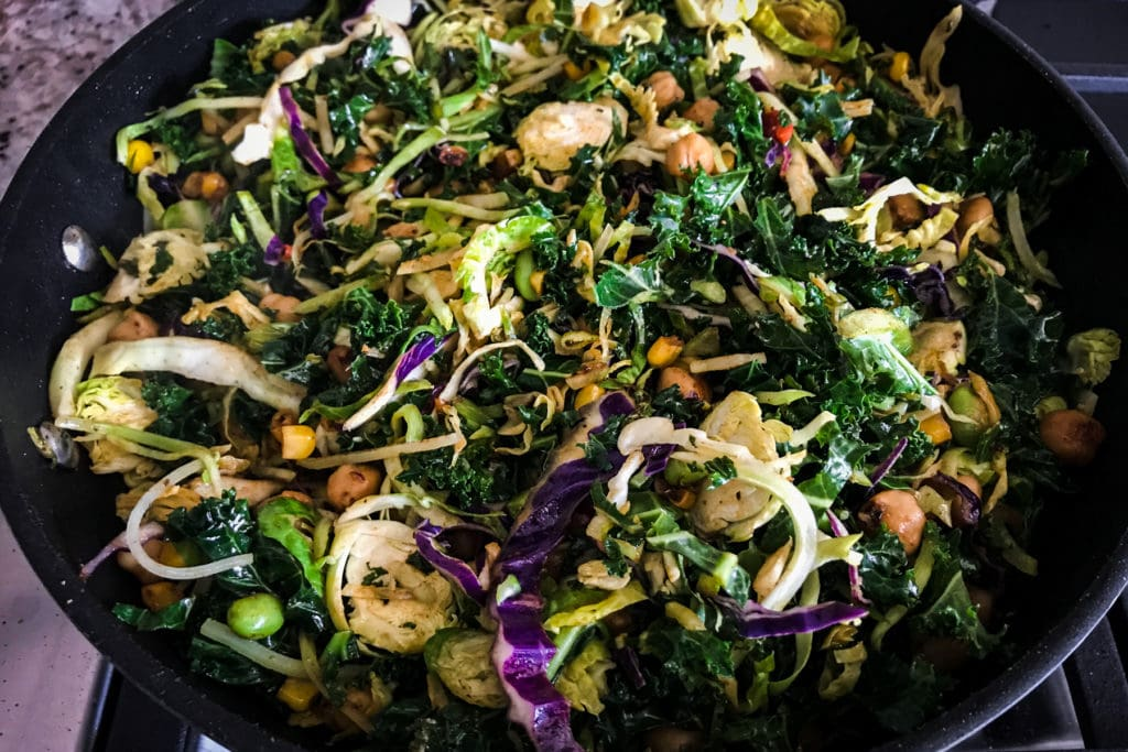 Kale and cabbage salad in a skillet