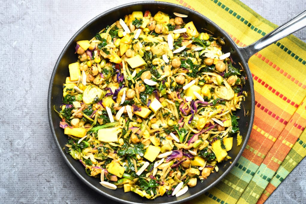 Chickpea kale salad with mango in skillet