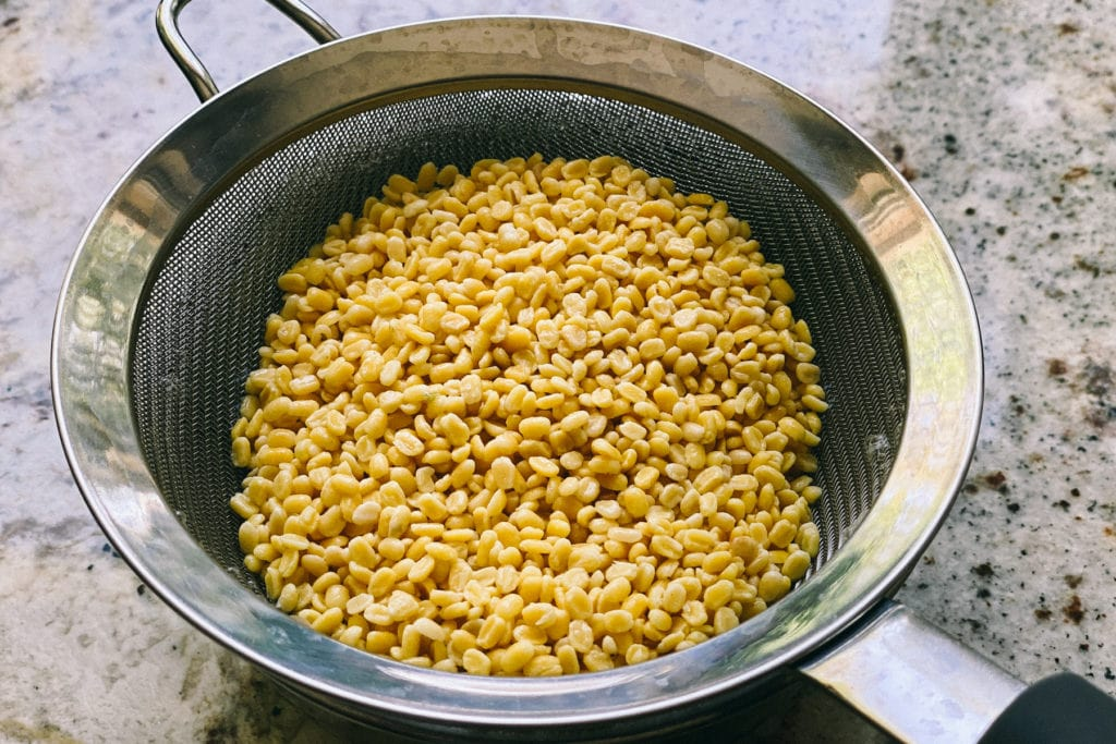 rinsed moong dal in a sieve