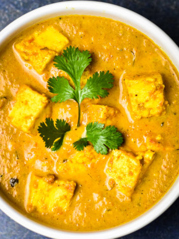 bowl of instant pot butter masala topped with cilantro