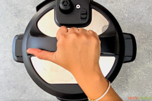 lid being placed on the instant pot