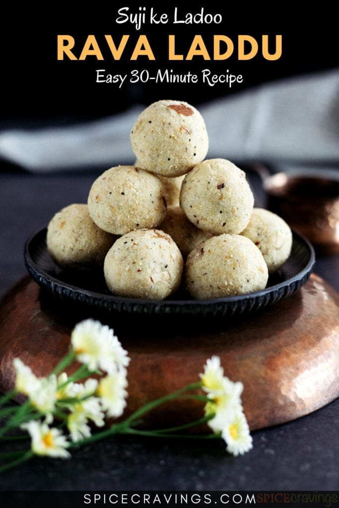 Rava laddu (ladoo) stacked on a metal plate placed on a copper bowl