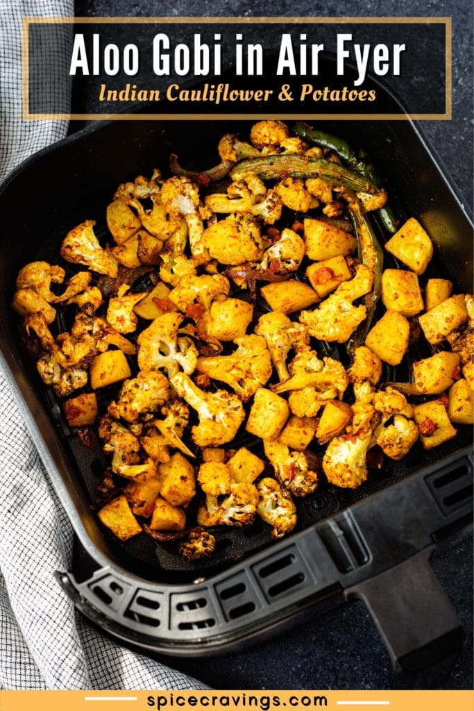 """picture of aloo gobi in the air fryer basket titled """"Aloo Gobi in Air Fryer: Indian Cauliflower and Potatoes"""""""