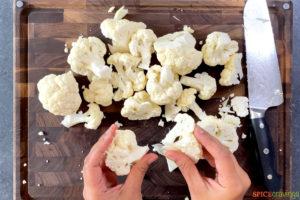 cauliflower being cut for aloo gobi