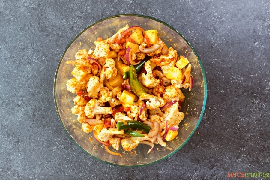 veggies for aloo gobi in a mixing bowl