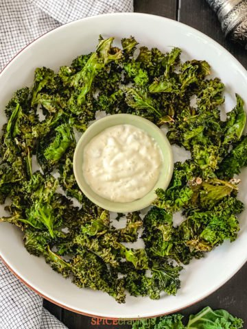White bowl with kale chips and dip