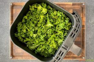 Kale leaves in air fryer basket
